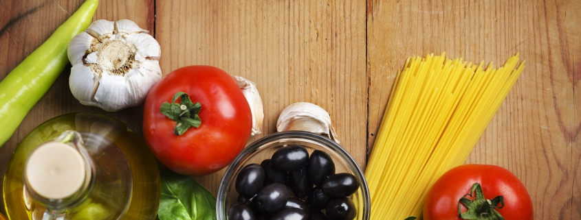 Food ingredients for italian pasta on a wooden table